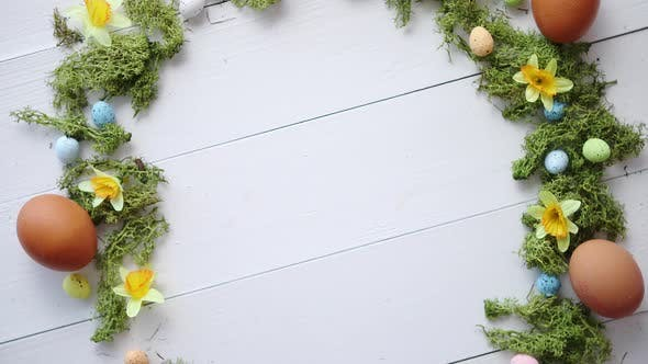Thumbnail for Colorful Decorative Easter Eggs Wreath on White Wooden Table Background