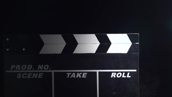 Movie Clapboard Action . Close Up. Black Background