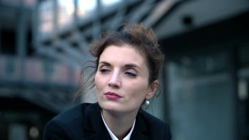 thoughtful sophisticated business woman - outdoor