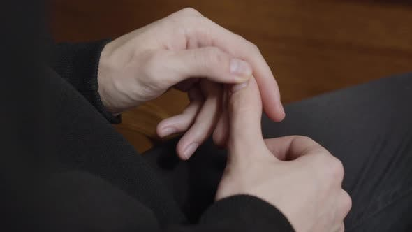 Thumbnail for Closeup Hands of Nervous Male Patient in Psychologist Office