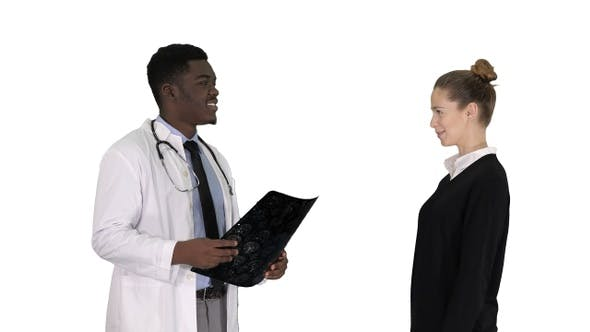 Physician showing a patient the X-ray results Then patient