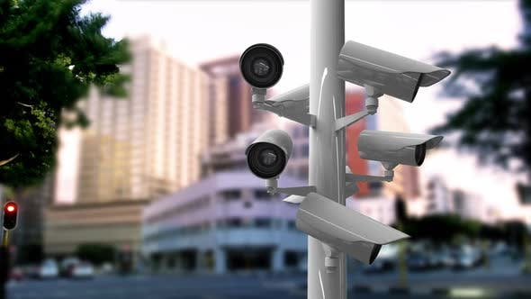 Surveillance cameras in a busy street