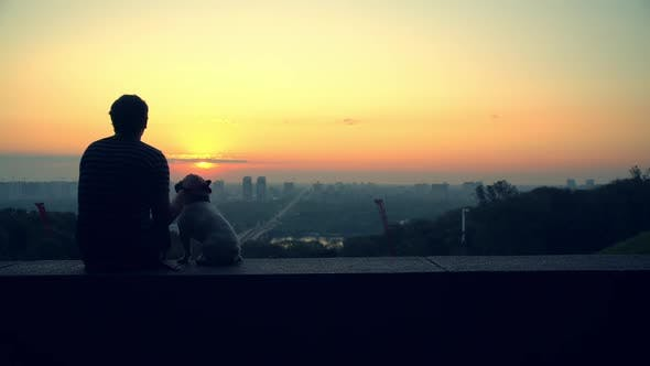 Thumbnail for A Man Caresses His Dog While Enjoying the View