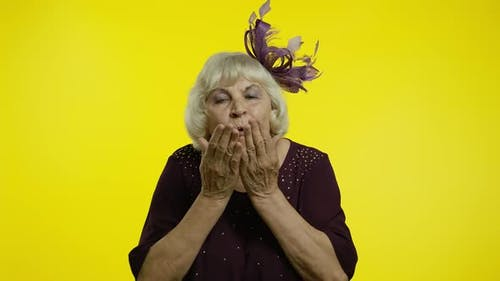 Happy Senior Old Woman Sending Air Fly Kisses To Camera, Demonstrating Love, Romantic Emotions