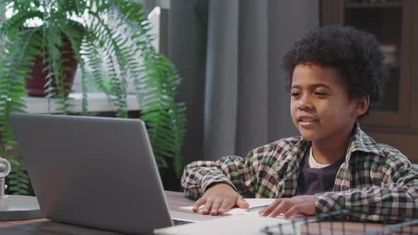 Afro Kid Studying Online At Home