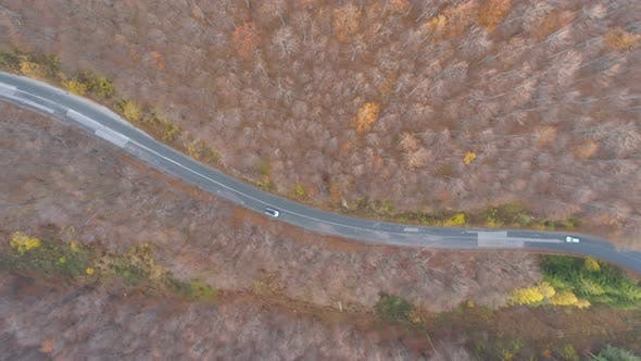 Thumbnail for Car Passing Mountain Road, Drone Follows Slow Driving Car