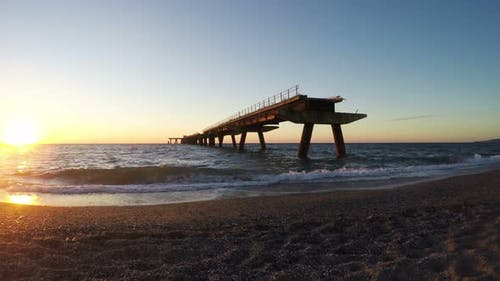 Destroyed Wharf at Sunset in South Italy