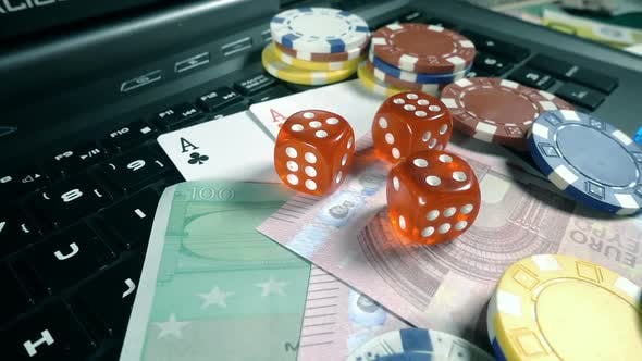 Thumbnail for Gambling Money Chips Poker Cards And Dices On Laptop Computer