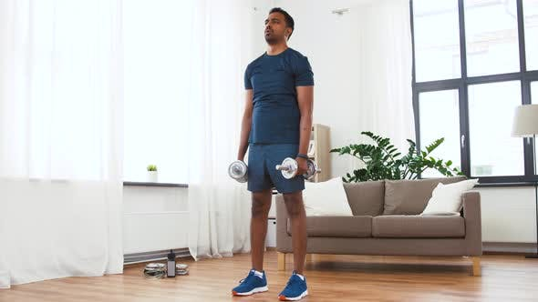 Thumbnail for Indian Man Exercising with Dumbbells at Home
