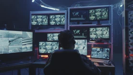 Hacker Watching Security Camera Footage