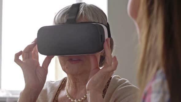 Thumbnail for Curious Elderly Woman in VR Goggles