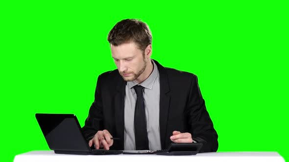 Cover Image for Examining Business Documets. Green Screen