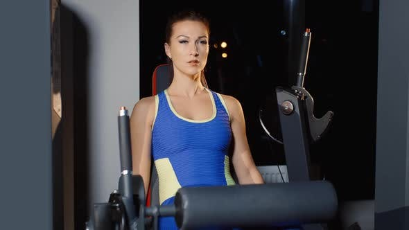 Thumbnail for Athletic Woman Trainig with Sport Simulator in Gym