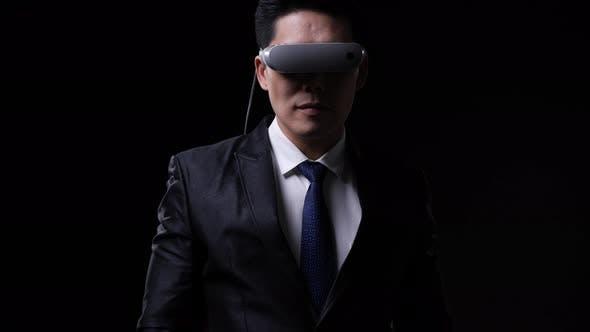 Businessman wearing modern smart glasses
