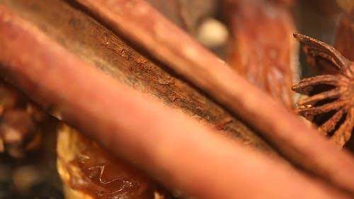 Closeup of Cinnamon Stick and Aniseed Rotating, Sweet and Savoury Food Additive