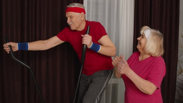 Thumbnail for Healthy Elderly Senior Grandfather Model Exercising Sport Workout on Orbitrek in Room at Home