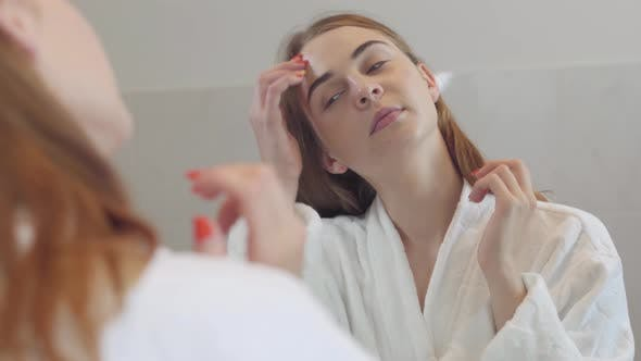 Thumbnail for Close-up Beauty Portrait of Young Woman with Smooth Healthy Skin, She Gently Touches Her Face with