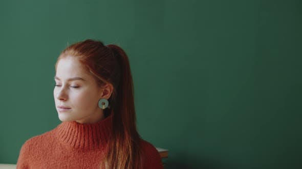 Thumbnail for Portrait of Beautiful Redhead Lady on Green Wall