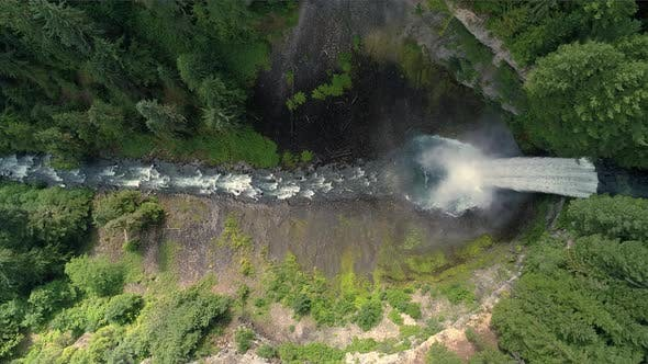 Thumbnail for 4K Helicopter Over Canyon Waterfall Into Crater In Canadian Wilderness 60P