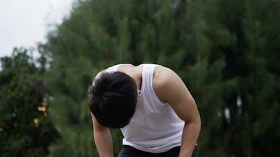 Man in earphone running and break