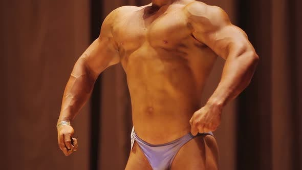 Thumbnail for Athletic Man Demonstrating Muscles, Front Lat Spread Pose, Bodybuilding Contest