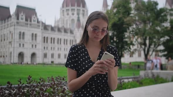 Girl with Mobile at Kossuth Square in Budapest Hungary