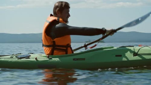 Man Rowing a Kayak