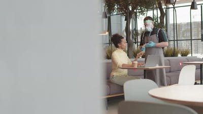 Customer Paying with Smartphone in Coffee Shop