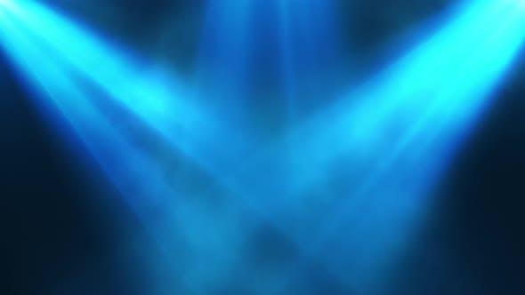 Bright Colorful Spotlights Shine Into the Scene in Smoke