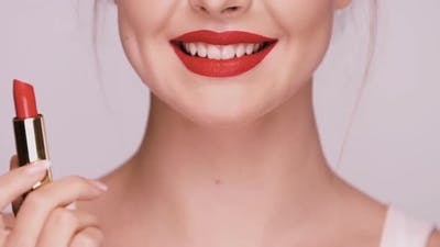 Close-up of Girl Applying Red Lipstick