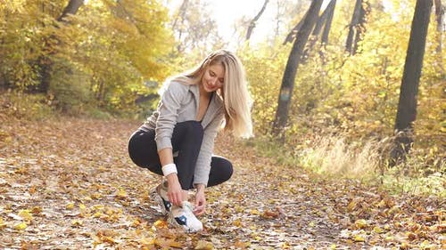 Attractive Slender Woman Ties Her Shoes Sneakers She Runs Through Autumn Forest Wears Sports Clothes