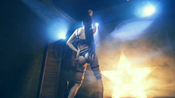 Thumbnail for Beautiful Woman In Black Lingerie With Sword And Leather Belt Domination And Dance Night Club Scene