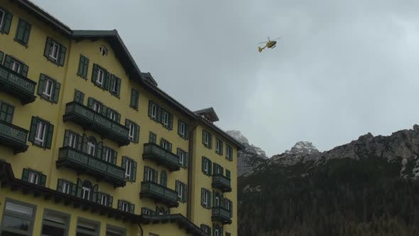 Thumbnail for Rescue Team Flying in Helicopter Above Mountains, Avalanche Accident Prevention