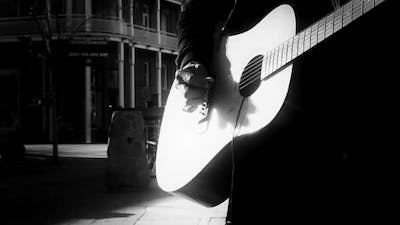 Acoustic Guitar Man on Street Black and White