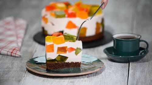 Cake With Colored Jelly. A Piece Of Cake Broken Glass.