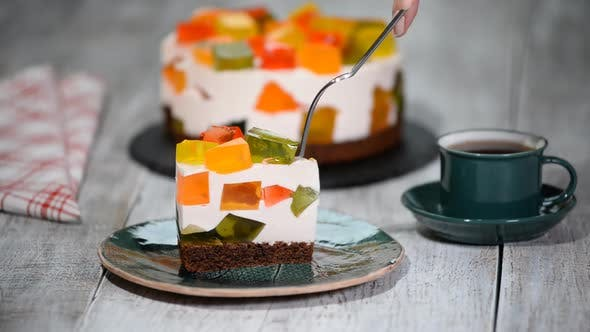 Cover Image for Cake With Colored Jelly. A Piece Of Cake Broken Glass.