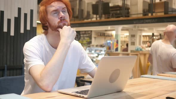 Thumbnail for Thinking, Pensive Redhead Beard Man Sitting in Cafe