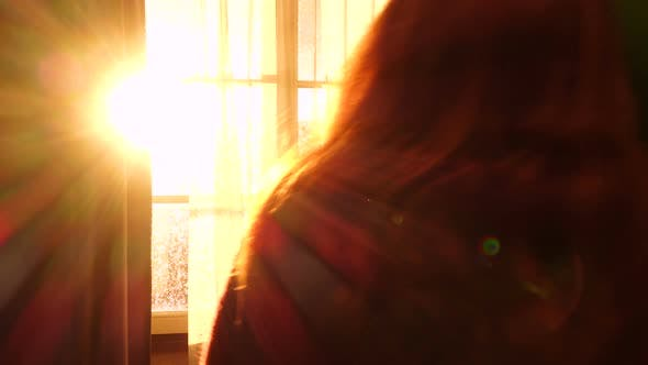 Thumbnail for Girl Opening A Window And Looking At The Evening City 2