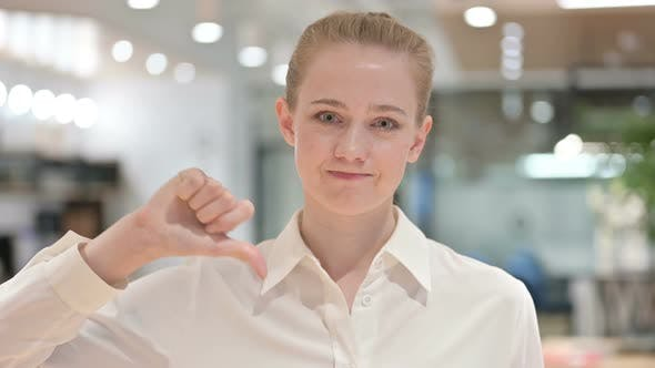 Thumbnail for Disappointed Businesswoman Doing Thumbs Down Sign