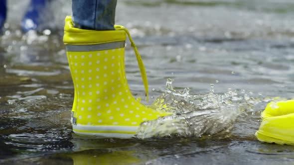 Thumbnail for Child Splashing Water in Puddle