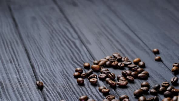 Thumbnail for Scattered coffee beans on wooden background