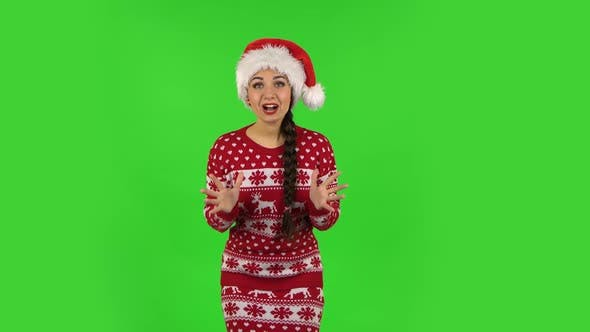Thumbnail for Sweety Girl in Santa Claus Hat with Shocked Surprised Wow Face Expression. Green Screen