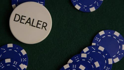 Rotating shot of poker cards and poker chips on a green felt surface - POKER 036