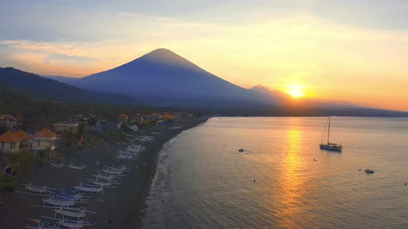 Thumbnail for Sunset Scenic View of Ocean and Agung Volcano From Amed Village, Bali, Indonesia. Aerial View