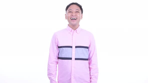 Thumbnail for Happy Japanese Businessman with Pink Shirt Smiling