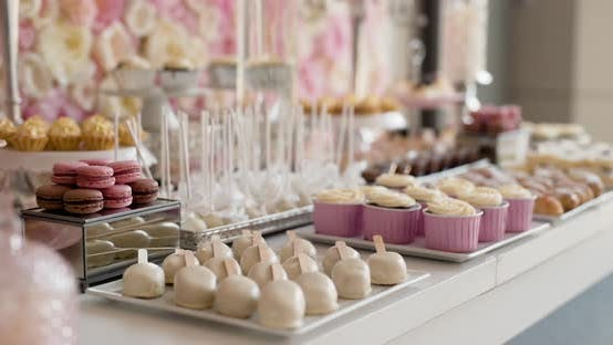 Cover Image for Cute Candy Bar with Various Cakes and Candies. Wedding Candybar.