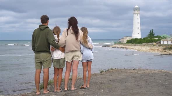 Thumbnail for Family of Four Walk To the Lighthouse