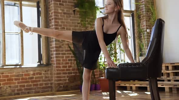 Thumbnail for Young Sportive Beautiful Girl Doing Stretching Legs in a Gym