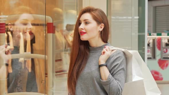 Thumbnail for Attractive Woman Enjoying Shopping at the Mall, Examining Clothes on Display