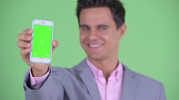 Thumbnail for Face of Happy Young Handsome Businessman Showing Phone